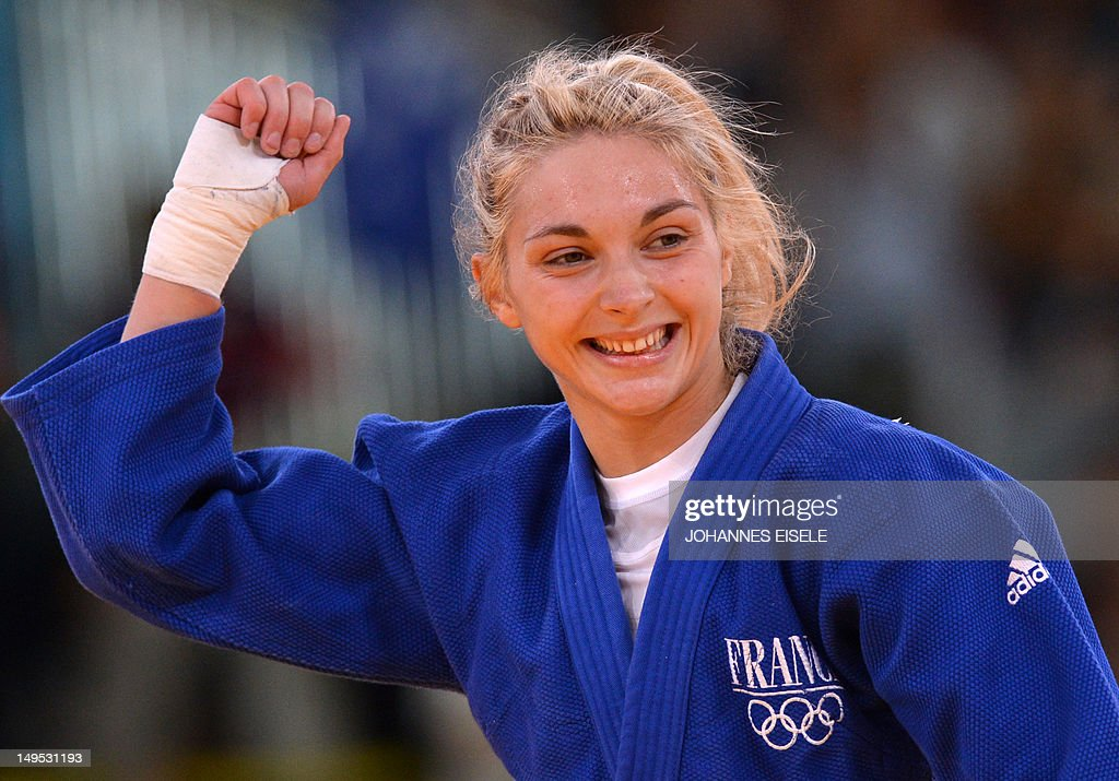 France's <a gi-track='captionPersonalityLinkClicked' href=/galleries/search?phrase=Automne+Pavia&family=editorial&specificpeople=7182223 ng-click='$event.stopPropagation()'>Automne Pavia</a> celebrates with her coach after winning against Hungary's Hedvig Karakas during their women's -57kg judo contest bronze medal match of the London 2012 Olympic Games on July 30, 2012 ExCel arena in London.