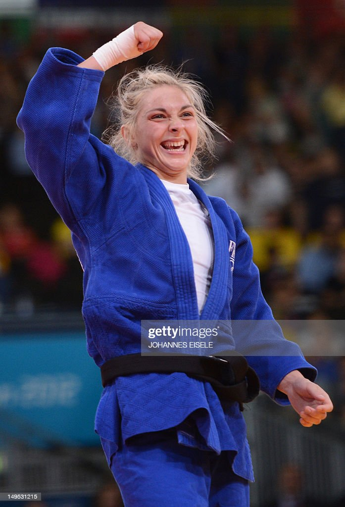 France's <a gi-track='captionPersonalityLinkClicked' href=/galleries/search?phrase=Automne+Pavia&family=editorial&specificpeople=7182223 ng-click='$event.stopPropagation()'>Automne Pavia</a> celebrates with her coach after winning against Hungary's Hedvig Karakas during their women's -57kg judo contest bronze medal match of the London 2012 Olympic Games on July 30, 2012 ExCel arena in London. AFP PHOTO / JOHANNES EISELE