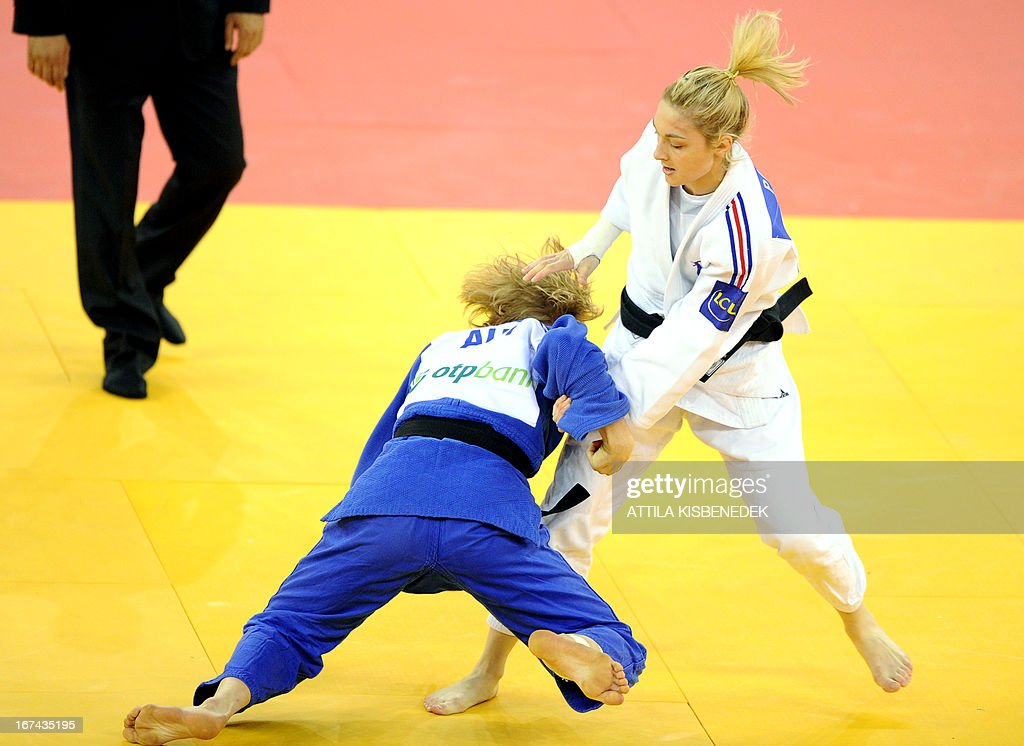 France's Automne Pavia (white) fights with Austria's Sabrina Filzmoser (blue) during their final of the Judo European Championships in 57kg category for women in Budapest. Pavia won the gold medal.