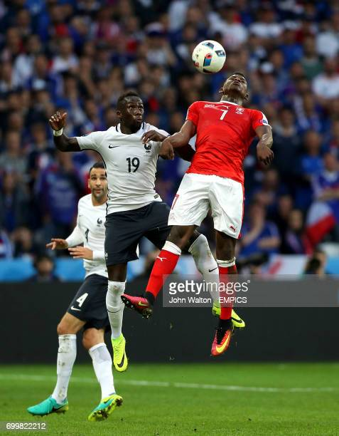 France's Bacary Sagna and Switzerland's Breel Embolo battle for the ball