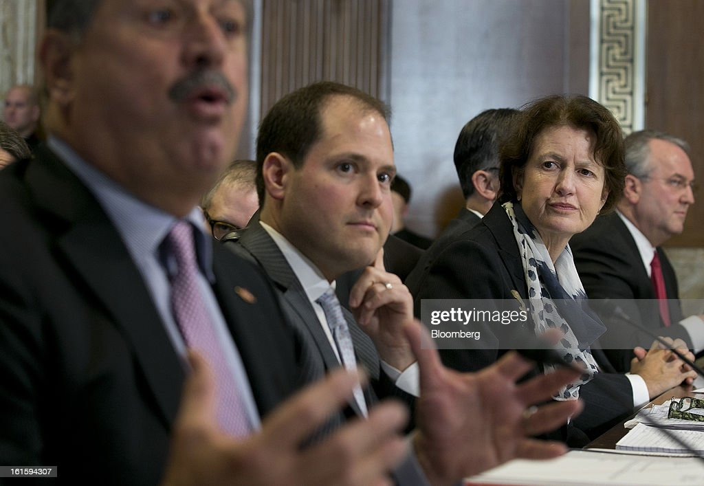 Frances Beinecke, president of the Natural Resources Defense Council, right, and Ross Eisenberg, vice president of energy and resources policy at the National Association of Manufacturers, center, listen as Andrew Liveris, chairman and chief executive officer of Dow Chemical Co., left, speaks during a Senate Energy and Natural Resources Committee hearing in Washington, D.C., U.S., on Tuesday, Feb. 12, 2013. The top two members of a Senate committee for energy split over expanding U.S. natural gas exports, mirroring a disagreement between fuel consumers such as Dow Chemical Co. and producers such as Exxon Mobil Corp. Photographer: Andrew Harrer/Bloomberg via Getty Images