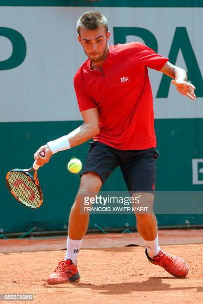 France's Benjamin Bonzi returns the ball to Russia's Daniil Medvedev during their qualification round match at the Roland Garros 2017 French Tennis...