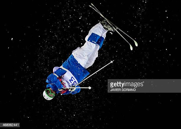 France's Benjamin Cavet celebrates his first run in the Men's Freestyle Skiing Moguls finals at the Rosa Khutor Extreme Park during the Sochi Winter...