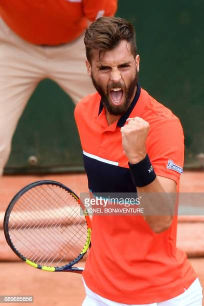 France's Benoit Paire celebrates after a point against Spain's Rafael Nadal during their tennis match at the Roland Garros 2017 French Open on May 29...