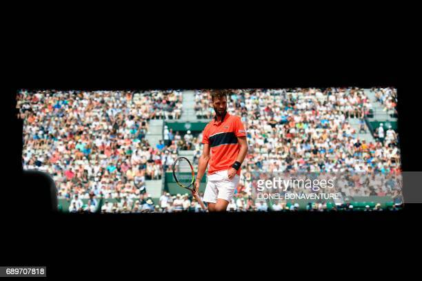 France's Benoit Paire reacts after a point against Spain's Rafael Nadal during their tennis match at the Roland Garros 2017 French Open on May 29...