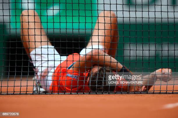 France's Benoit Paire reacts after Spain's Rafael Nadal won their tennis match at the Roland Garros 2017 French Open on May 29 2017 in Paris / AFP...
