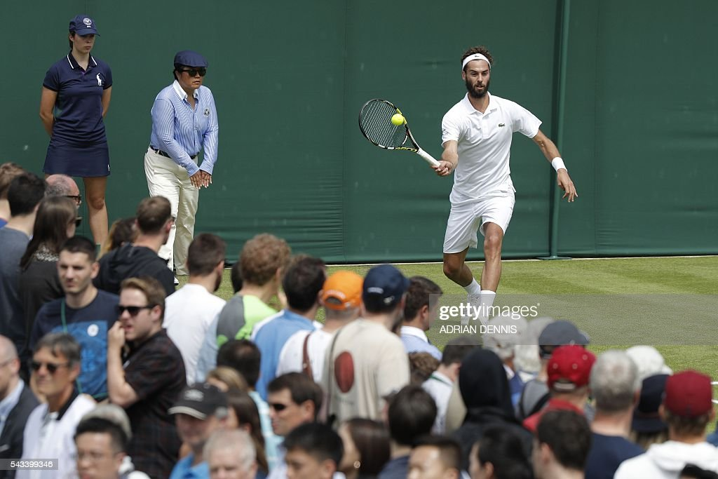 France's Benoit Paire returns against Croatia's Franko Skugor during their men's singles first round match on the second day of the 2016 Wimbledon Championships at The All England Lawn Tennis Club in Wimbledon, southwest London, on June 28, 2016. / AFP / ADRIAN