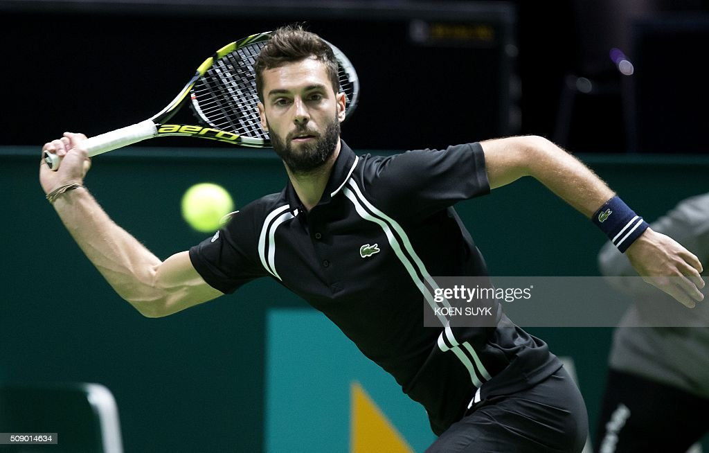 France's Benoit Paire returns the ball to Ivan Dodig of Croatia during the first round of the ABN AMRO World Tennis Tournament in Rotterdam on February 8, 2016. / AFP / ANP / Koen Suyk / Netherlands OUT