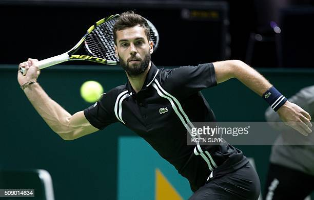 France's Benoit Paire returns the ball to Ivan Dodig of Croatia during the first round of the ABN AMRO World Tennis Tournament in Rotterdam on...