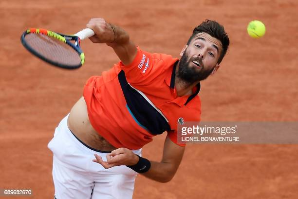 France's Benoit Paire serves to Spain's Rafael Nadal during their tennis match at the Roland Garros 2017 French Open on May 29 2017 in Paris / AFP...