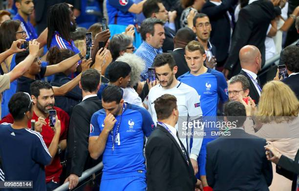 France's Blaise Matuidi and France goalkeeper Hugo Lloris show dejection after collecting their runners up medals after losing to Portugal in the...