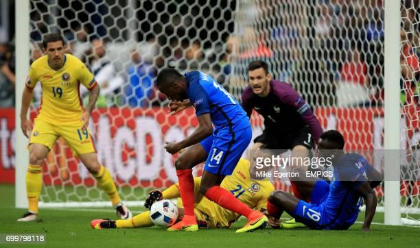 France's Blaise Matuidi and Romania's Dragos Grigore battle for the ball