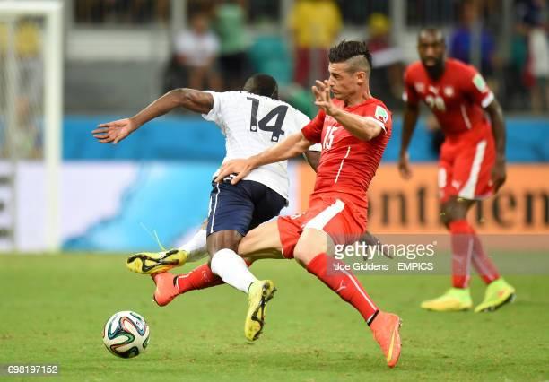 France's Blaise Matuidi and Switzerland's Blerim Dzemaili battle for the ball