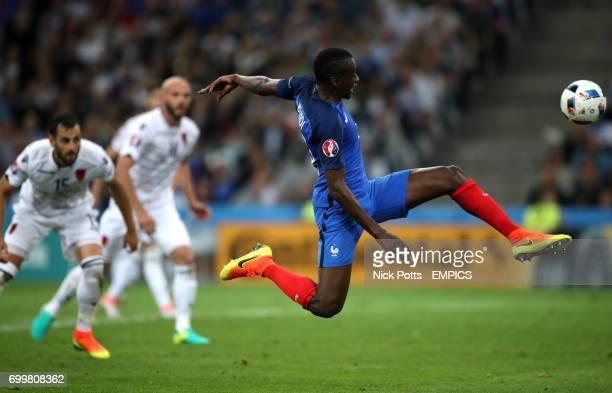 France's Blaise Matuidi stretches to reach the ball in the air