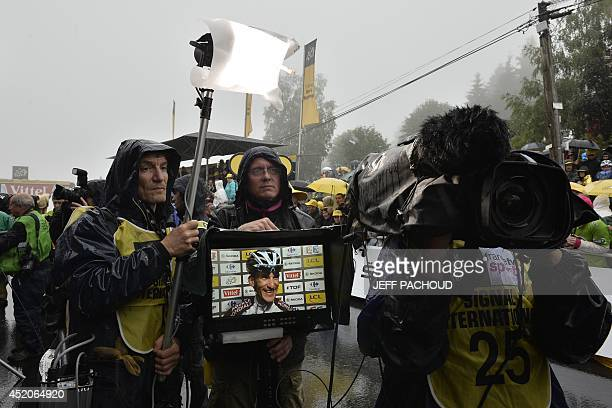 France's Blel Kadri is seen on a screen during an interview after he won the 161 km eighth stage of the 101st edition of the Tour de France cycling...