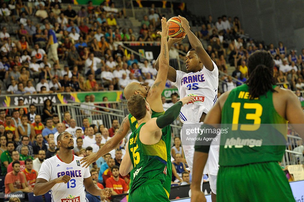 France's Boris Diaw (13) and Mickael Gelabale (15) vie with Brazil's Tiago Splitter (15) and Hilario Nene (13) during the 2014 FIBA World basketball championships group A match between France and Brazil at the Palacio Municipal de Deportes in Granada, Spain on August 30, 2014.