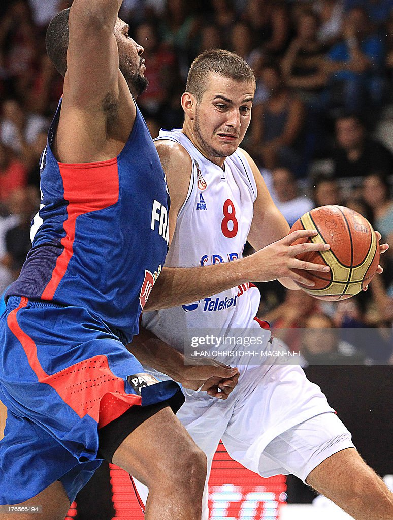 France's Boris Diaw (L) challenges Serbia's Nemanja Bjelica (R) during a friendly basketball match between France and Serbia on August 15, 2013 in Antibes, southeastern France as part of the preparation for the 2013 EuroBasket in Slovenia.