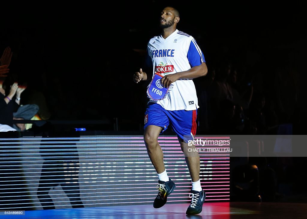 France's Boris Diaw enters the pitch before the basketball match between France and Japan at the Kindarena hall in Rouen on June 28, 2016. / AFP / CHARLY