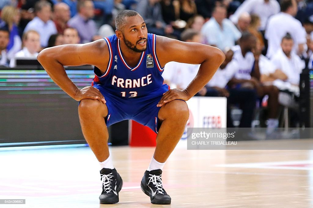 France's Boris Diaw streches during the friendly basketball match between France and Japan at the Kindarena hall in Rouen on June 28, 2016. / AFP / CHARLY