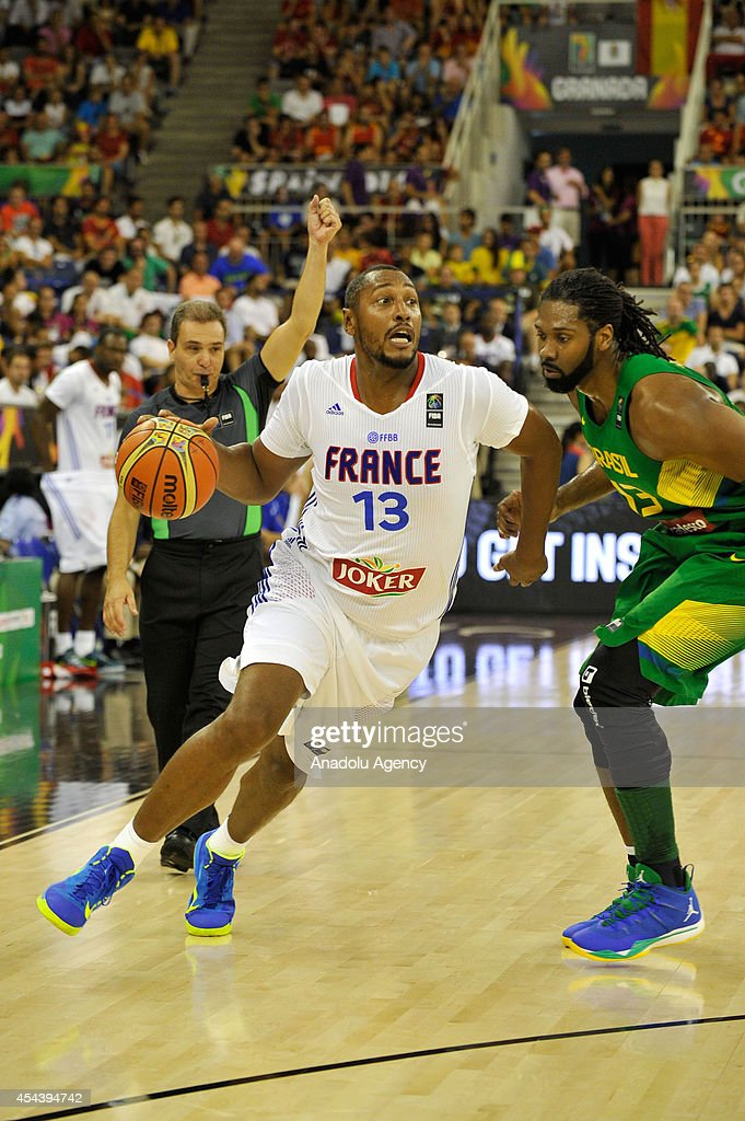 France's Boris Diaw (13) vies with Brazil's Nene Hilario (13) during the 2014 FIBA World basketball championships group A match between France and Brazil at the Palacio Municipal de Deportes in Granada, Spain on August 30, 2014.