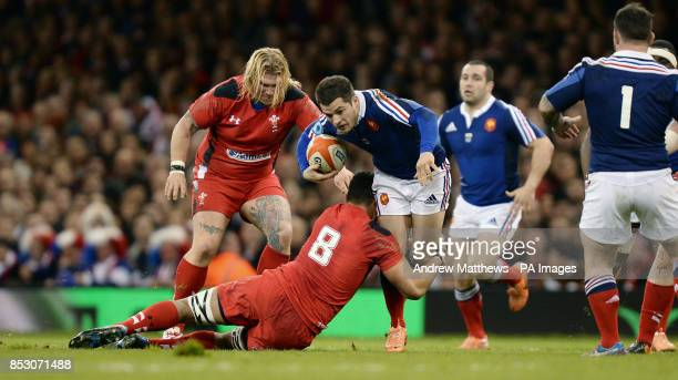 France's Brice Dulin is tackled by Wales' Taulupe Faletau during the RBS 6 Nations match at the Millennium Stadium Cardiff