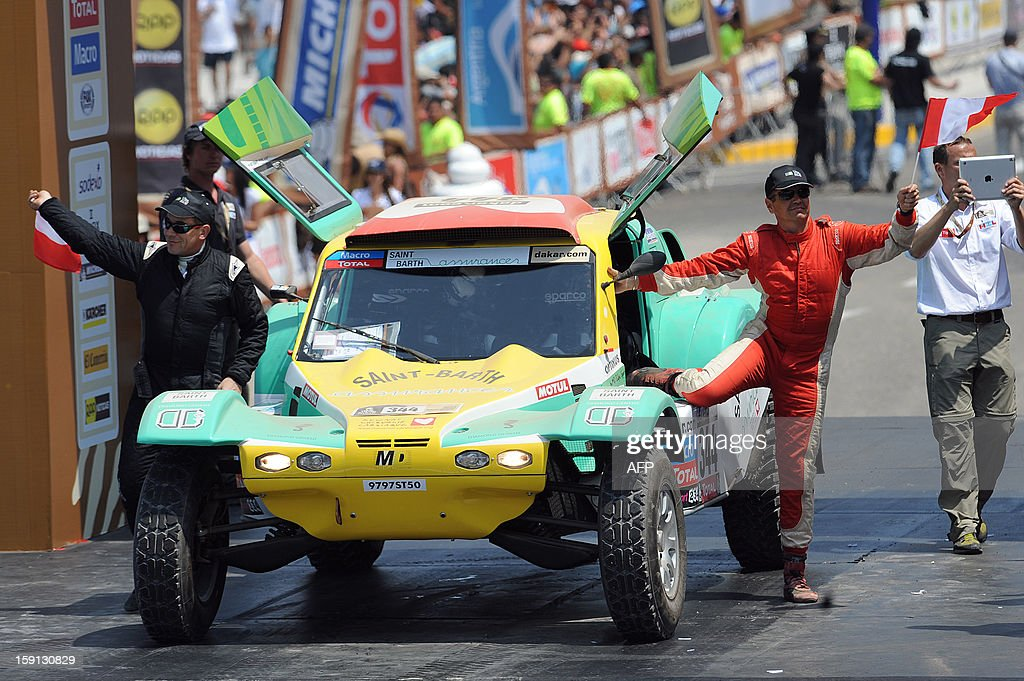 France´s Bruno Miot (R) and Pascal Gambillon are seen next to their MD Rallye during the 2013 Dakar Rally departure ceremony in Lima on January 5, 2013.
