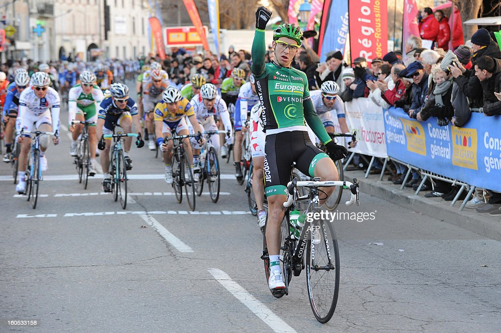 France's Bryan Coquard (C) celebrates as he wins the finish line at the end of the fourth stage of the 43rd Etoile de Besseges cycling race between Sabran and Pont Saint Esprit on February 2, 2013 in Pont Saint Esprit, southeastern France. AFP PHOTO / SYLVAIN THOMAS