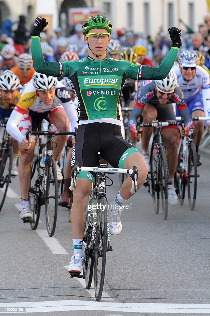 France's Bryan Coquard (C) celebrates as he wins the finish line at the end of the fourth stage of the 43rd Etoile de Besseges cycling race between Sabran and Pont Saint Esprit on February 2, 2013 in Pont Saint Esprit, southeastern France.