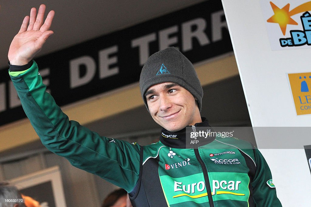 France's Bryan Coquard waves on the podium after winning the fourth stage of the 43rd Etoile de Besseges cycling race between Sabran and Pont Saint Esprit on February 2, 2013 in Pont Saint Esprit, southeastern France.