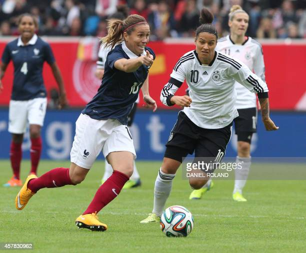 France's Camille Abily and Germany's Dzsenifer Marozsan vie for the ball during the friendly women football match Germany vs France in Offenbach...