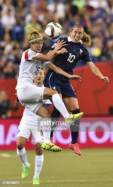 France's Camille Abily and South Korea's Kang Yumi fight for the ball during a 2015 FIFA Women's World Cup round of 16 match at the Olympic Stadium...