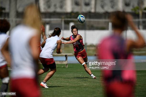 France's Camille Grassineau passes the ball during their women's rugby sevens training session in Deodoro a neighborhood of Rio de Janeiro on August...