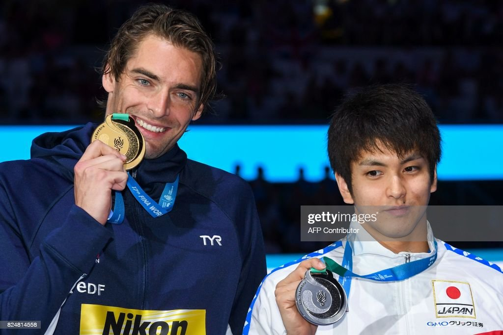 France's Camille Lacourt and Japan's Junya Koga poses with their gold medal on the podium of the men's 50m backstroke during the swimming competition at the 2017 FINA World Championships in Budapest, on July 30, 2017. /