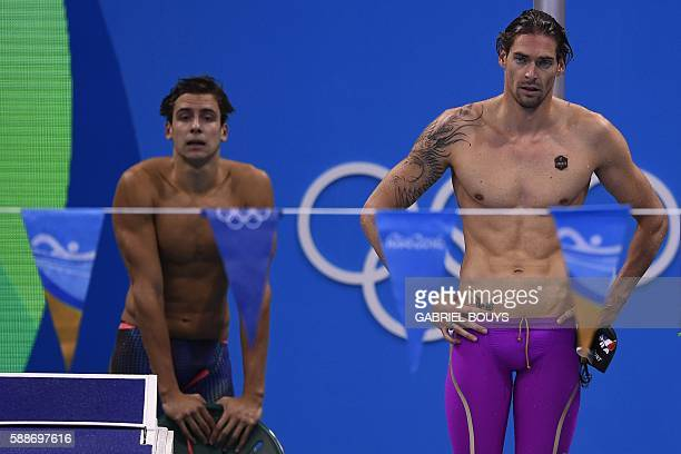 France's Camille Lacourt and Theo Bussiere react during the Men's 4x100m Medley Relay heat 2 during the swimming event at the Rio 2016 Olympic Games...