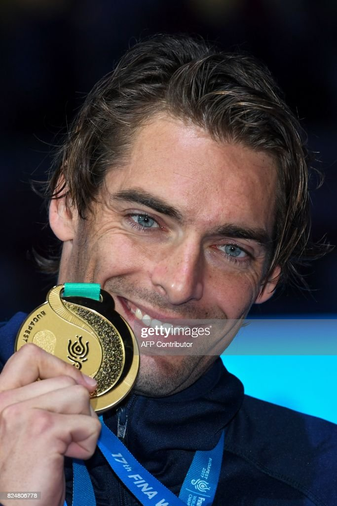 France's Camille Lacourt poses with his gold medal on the podium of the men's 50m backstroke during the swimming competition at the 2017 FINA World Championships in Budapest on July 30, 2017. /