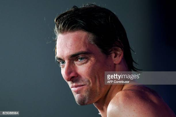 France's Camille Lacourt reacts after winning the final of the men's 50m backstroke during the swimming competition at the 2017 FINA World...