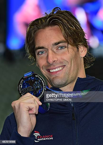 France's Camille Lacourt silver poses during the podium ceremony of the men's 100m backstroke swimming event at the 2015 FINA World Championships in...