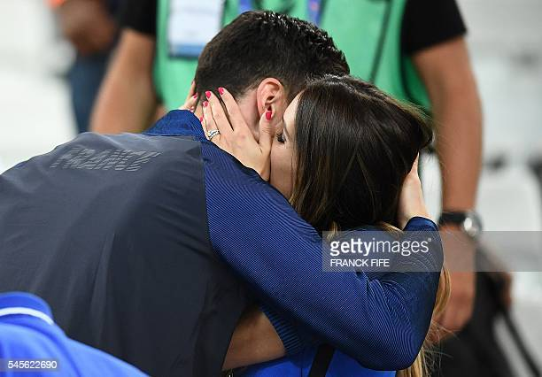 France's captain and goalkeeper Hugo Lloris kiss his wife Marine Lloris as they celebrate the team's 20 win over Germany in the Euro 2016 semifinal...