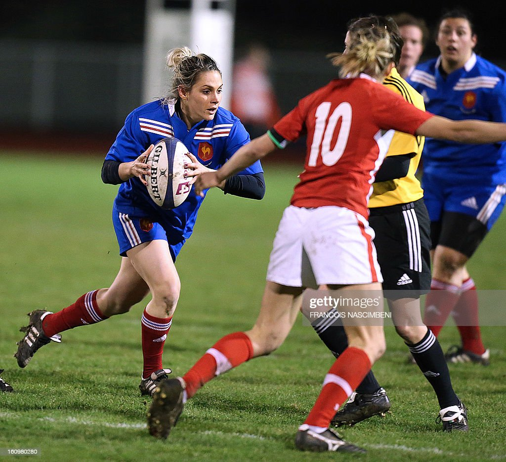 France's captain Marie-Alice Yahe (L) runs with the ball during the Six Nations women Rugby Union match France vs Wales on February 8, 2013 in Laon, northern France.