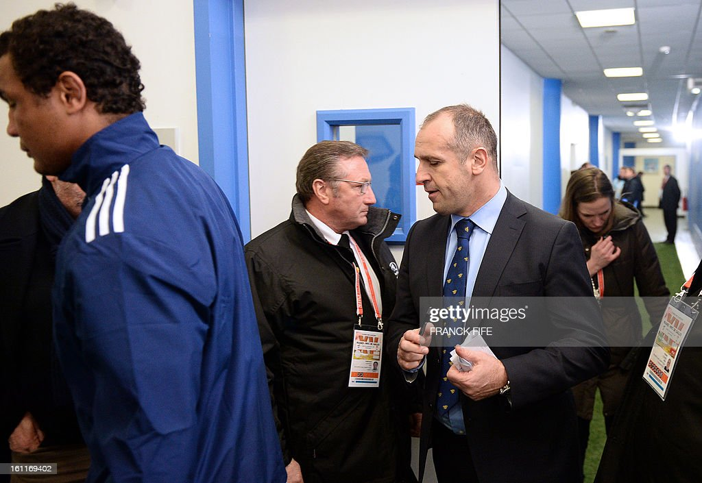 France's captain Thierry Dusautoir (L) and France's head coach Philippe Saint Andre (C) leave a locker room after the Six Nations Rugby Union match between France and Wales at the Stade de France on February 9, 2013 in Saint-Denis, north of Paris.