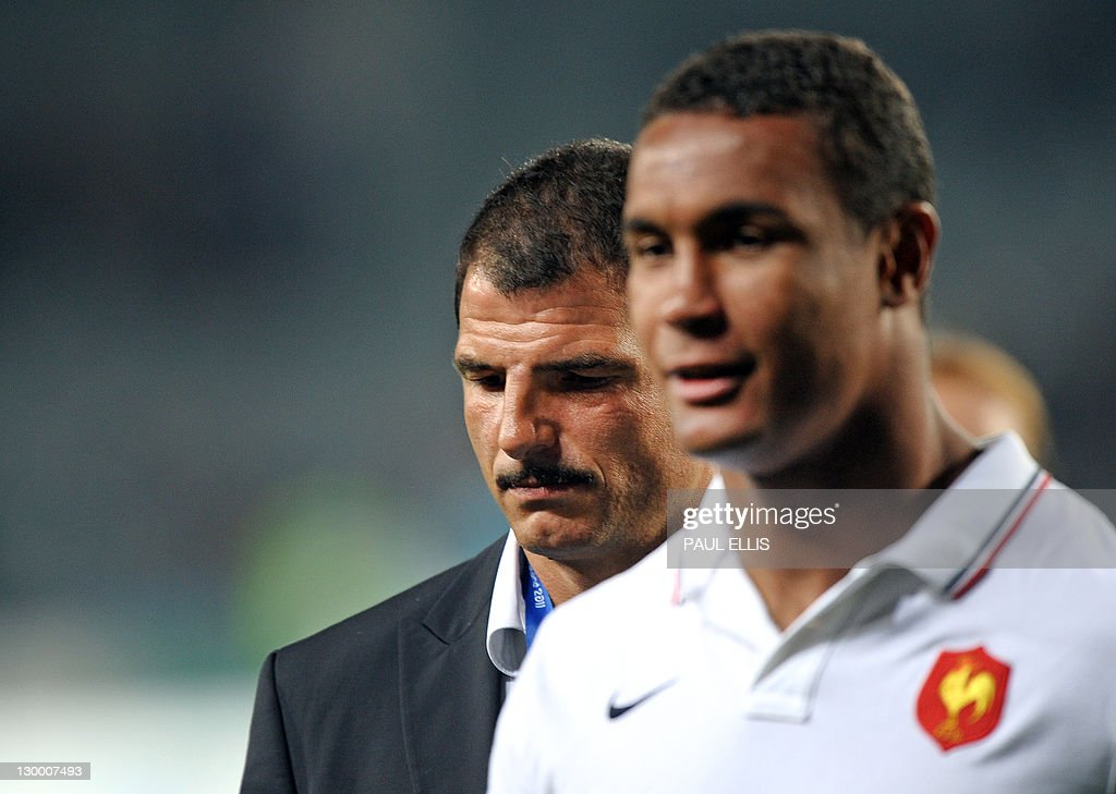 France's captain Thierry Dusautoir (L) and Marc Lievremont react after the 2011 Rugby World Cup final match New Zealand vs France at Eden Park Stadium in Auckland on October 23, 2011. AFP PHOTO / PAUL ELLIS