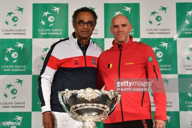 France's captain Yannick Noah and Belgium's captain Johan Van Herck pose with the trophy during the team presentation in Villeneuved'Ascq on November...