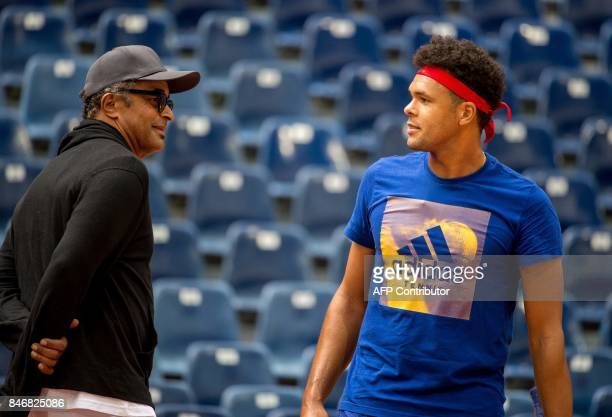 France's captain Yannick Noah and JoWilfried Tsonga take part in a training session of the French team ahead of the Davis Cup World Group semifinal...