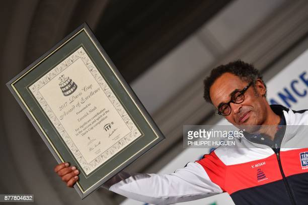 France's captain Yannick Noah poses after having been awarded with the 2017 Davis Cup of Exellence prize in Villeneuved'Ascq on November 23 ahead of...