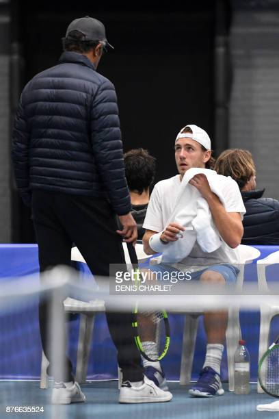 France's captain Yannick Noah speaks with Lucas Pouille during a training of France team players in MarcqenBaroeul northern France on November 20...