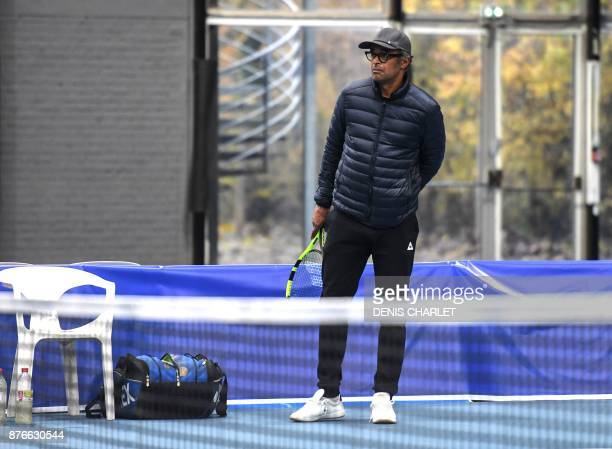 France's captain Yannick Noah watches during a training of France team players in Marcq en Baroeul northern France on November 20 2017 ahead of the...