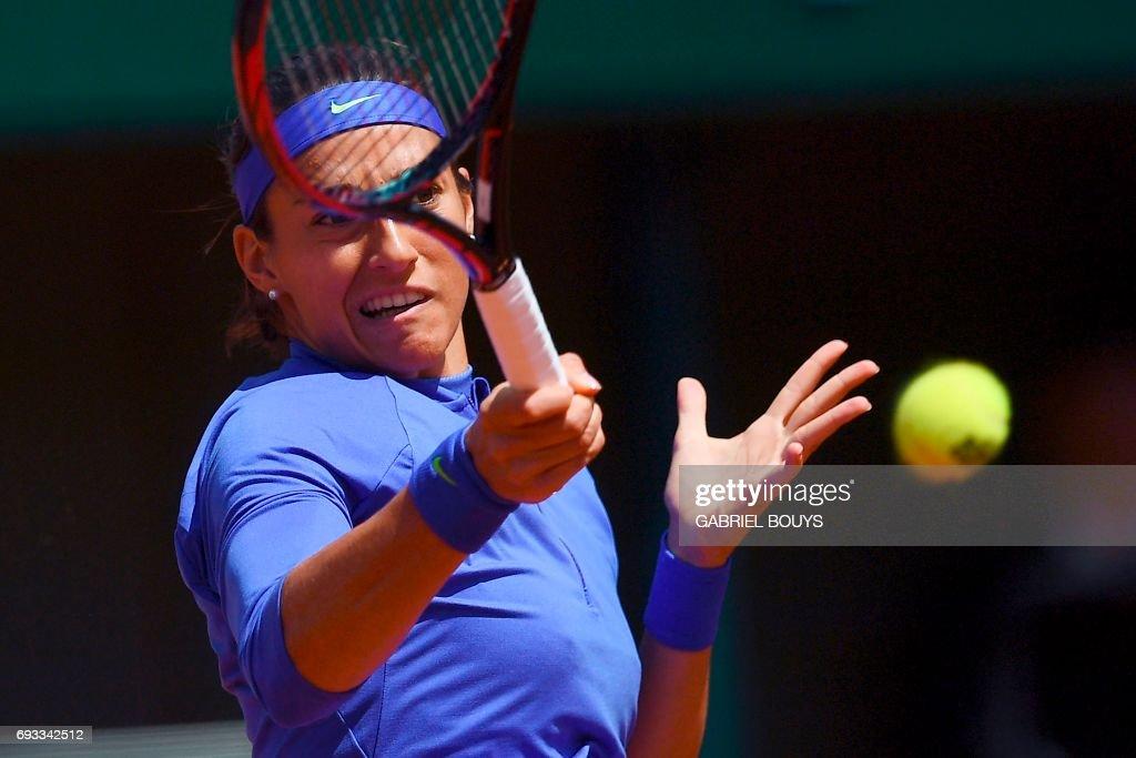 France's Caroline Garcia returns the ball to Czech Republic's Karolina Pliskova during their tennis match at the Roland Garros 2017 French Open on June 7, 2017 in Paris. /