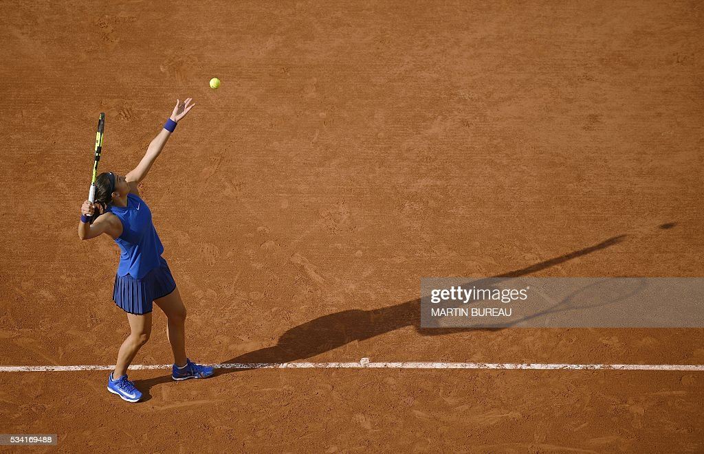 France's Caroline Garcia serves the ball to Poland's Agnieszka Radwanska during their women's second round match at the Roland Garros 2016 French Tennis Open in Paris on May 25, 2016. / AFP / MARTIN