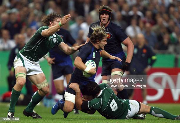 France's Cedric Heymans is brought down by Ireland's Denis Leamy