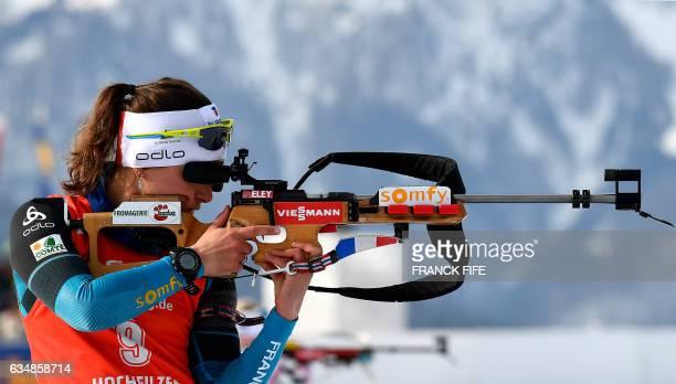 France's Celia Aymonier shoots during the Women's 10 km pursuit race during the 2017 IBU World Championships Biathlon in Hochfilzen on February 12...